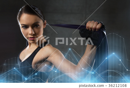 woman with expander exercising in gym 36212108