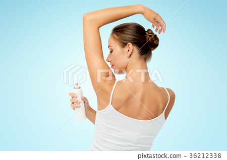 woman with antiperspirant deodorant over white 36212338