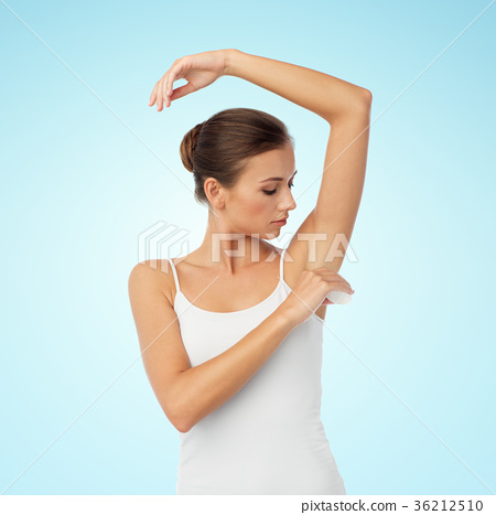 woman with antiperspirant deodorant over white 36212510
