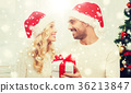 happy couple at home with christmas gift box 36213847