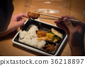 Young man eating convenience store lunch box 36218897