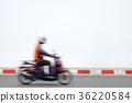Motion blur bike rider on the street 36220584