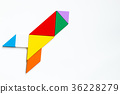 Colorful wood tangram puzzle in rocket or missile 36228279