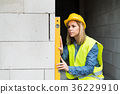 Young woman worker on the building site. 36229910