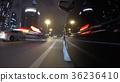 Fast city drive night road POV through city at 36236410