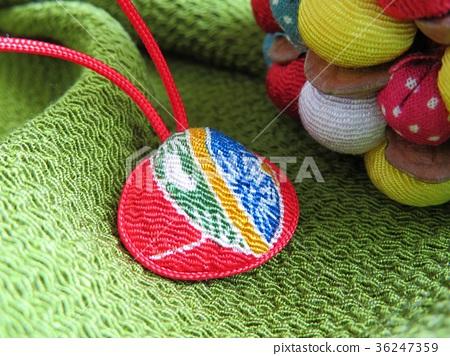 Japanese cloth handicraft shell netsuke and colorful pine cones 36247359