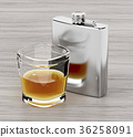 Hip flask and a glass of brandy 36258091