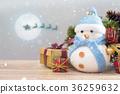 Happy snowman standing inchristmas background. 36259632