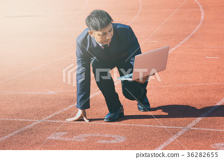 A businessman on a track ready for race in business 36282655