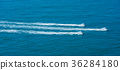 Aerial flying view of jet ski riding in Normandie 36284180