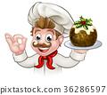 Chef Holding Christmas Pudding 36286597