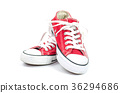 Red sneakers on a white background. 36294686