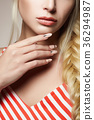 female hand with manicure. beautiful blonde hair 36294987