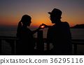 Silhouette of happy young couple in sunset. 36295116