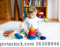 Adorable cute beautiful little baby girl playing 36308946