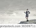 Woman with baseball bat 36309711
