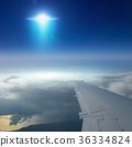 Ufo with bright spotlight flies near airplane  36334824