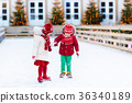 Kids ice skating in winter. Ice skates for child. 36340189