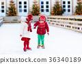 Kids ice skating in winter. Ice skates for child. 36340189
