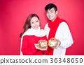 couple take piggy bank 36348659
