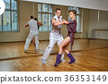 beautiful couple dancing bachata in dance studio 36353149
