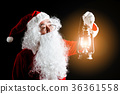 Santa Claus with lantern of Christmas in hands. 36361558