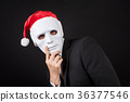 Young Asian businessman wearing white mask and santa hat 36377546