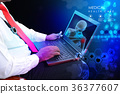 Doctor with stethoscope and laptop 36377607