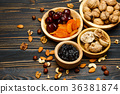 dried fruits figs, apricots, plums and nuts on 36381874