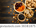 dried fruits figs, apricots, plums and nuts on 36381875