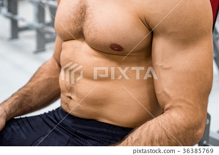 Close-up torso of male athlete at gym 36385769