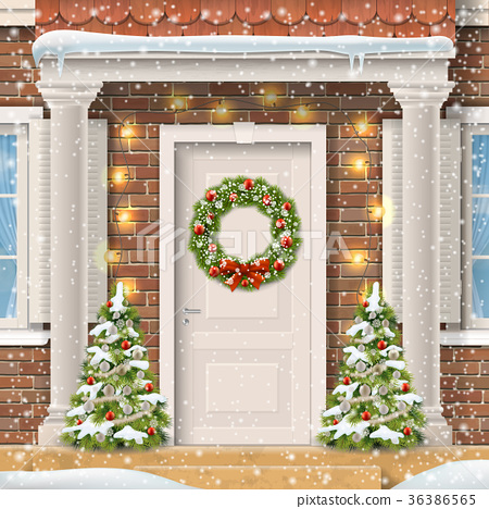 The door decorated with a Christmas wreath 36386565