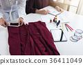 Two professional stylish fashion designer working as fashion des 36411049