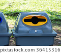 Gray bins for waste sorting are in the public park 36415316