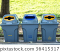 Gray bins for waste sorting are in the public park 36415317