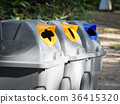 Gray bins for waste sorting are in the public park 36415320