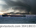 Ship in the tempest huricane cyclone 36418633