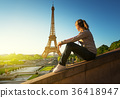girl looking at the Eiffel tower, Paris 36418947