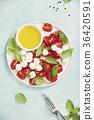 Caprese salad with basil and mozzarella balls 36420591