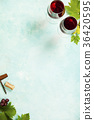 Wine and grapes over blue vintage background 36420595