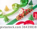 Santa claus driving train on ribbon with tree 36439838