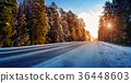 Car tires on winter road 36448603
