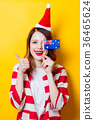 woman in Santa Claus hat with Australia flag 36465624