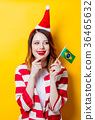 woman in Santa Claus hat with Brasil flag 36465632