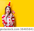 woman in Santa Claus hat with Canada flag 36465641