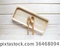 Wooden kitchen utensils on wooden background 36468094