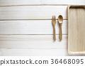Wooden kitchen utensils on wooden background 36468095
