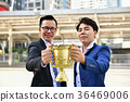 Young businessmen are competing for wins and trophies. 36469006
