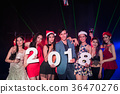 Teenagers are celebrating at the night party. 36470276