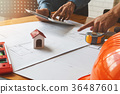Confident team of architect working together  36487601